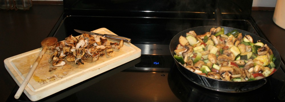 Chop up one of every vegetable + left over chicken = simple meal!